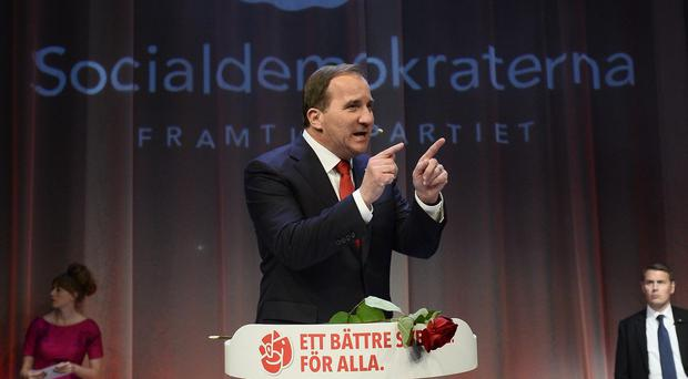 Opposition leader Stefan Lofven gestures while speaking at the election night party of the Social Democrats, in Stockholm, Sweden, on Sunday, Sept. 14, 2014. Sweden's Social Democrats were poised to return to power as the leaders of a left-leaning bloc that defeated the center-right government in a parliamentary election Sunday, but without an absolute majority. (AP Photo / News Agency TT, Claudio Bresciani) SWEDEN OUT