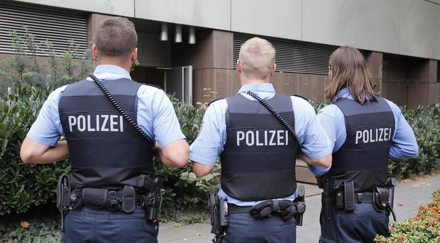 German police officers guard outside the regional court in Frankfurt as a 20-year-old went on trial, accused of being a member of IS (AP)