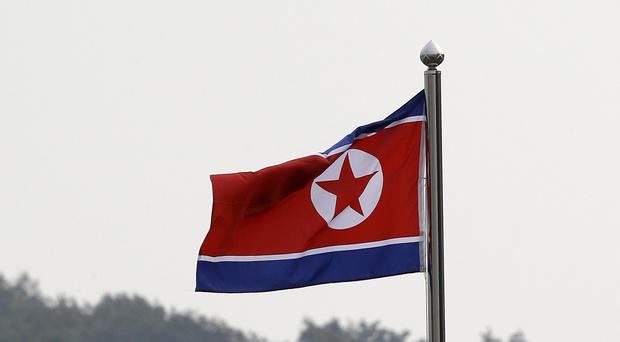The US man told investigators he had been trying to go to North Korea (AP)