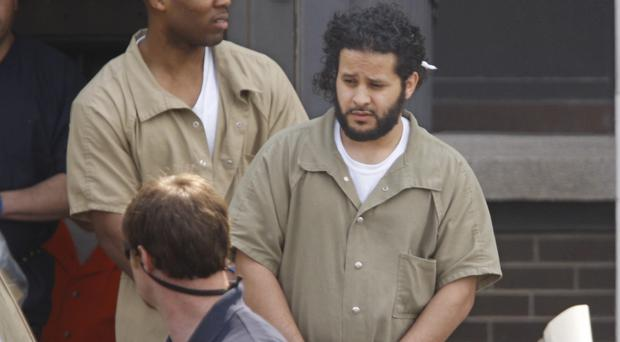 US Marshalls lead Mufid Elfgeeh out of court following a hearing in Rochester (AP)