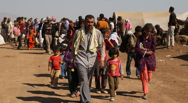 Many people are fleeing Syria following the capture by the Islamic State of Kurdish villages (AP)