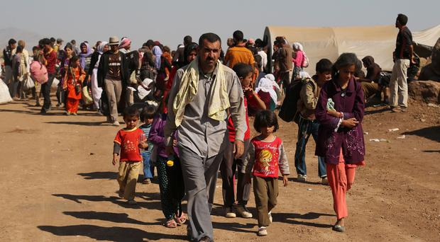 Many people have been fleeing Syria following the capture by the Islamic State of Kurdish villages (AP)
