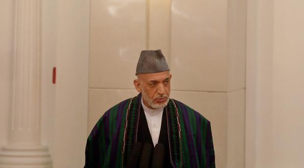 Hamid Karzai said the US did not want peace in Afghanistan (AP)