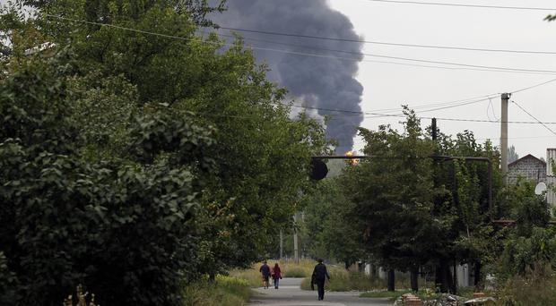 Smoke rises over a residential area in the north of the rebel-held city of Donetsk. (AP)