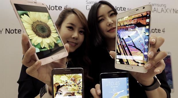 Samsung unveils its latest Galaxy Note 4 and Galaxy Note Edge smartphones in Seoul, South Korea (AP)