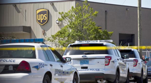 Police cars at the UPS warehouse in Birmingham, Alabama (AP)