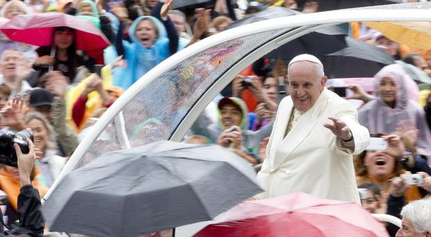 Pope Francis arrives for his weekly general audience at the Vatican (AP)