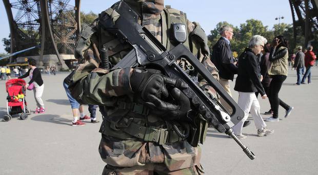 French soldiers have been seen on the streets of Paris since Herve Gourdel was abducted in Algeria (AP)