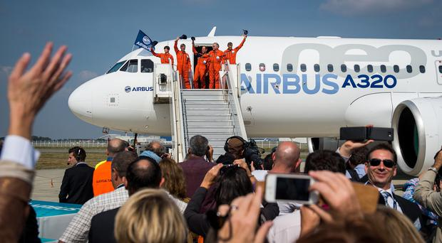 Airbus test pilots and engineers wave after the Airbus A320neo made its maiden flight at Toulouse. (AP)
