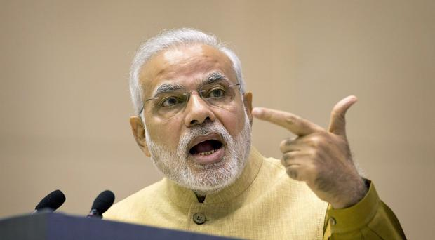 Indian Prime Minister Narendra Modi is being sued Modi in New York for what it says was his complicity in sectarian violence in his country in 2002 (AP)
