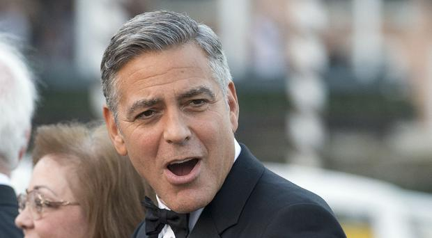 George Clooney arrives at the Aman Hotel where he is expected to marry Amal Alamuddin (AP)