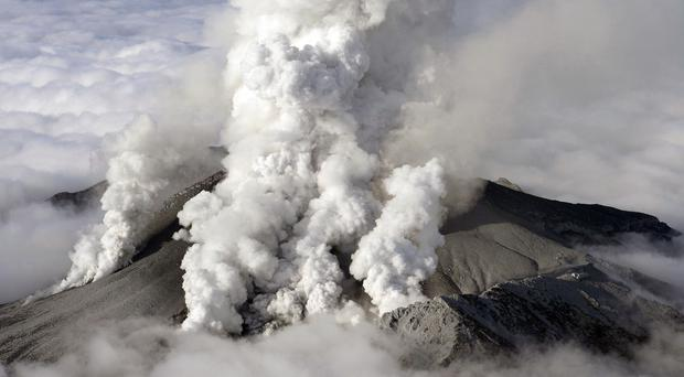 Dense plumes are spewed out from Mount Ontake as the volcanic mountain erupts (Kyodo News/AP)