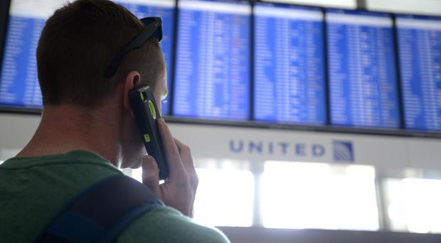 Flights in and out of Chicago's two airports were halted after a contract worker started a fire at an air traffic control centre (AP)