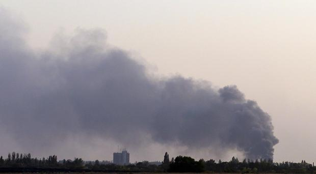 Smoke rises after shelling near the town of Donetsk, eastern Ukraine (AP)