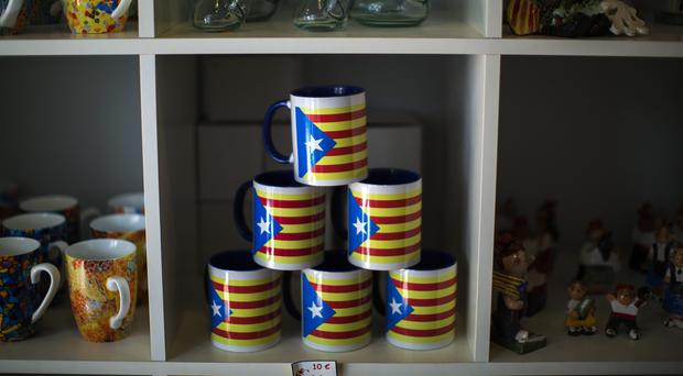 Mugs decorated with estelada flags, which symbolise Catalonia's independence, on sale in Barcelona (AP)