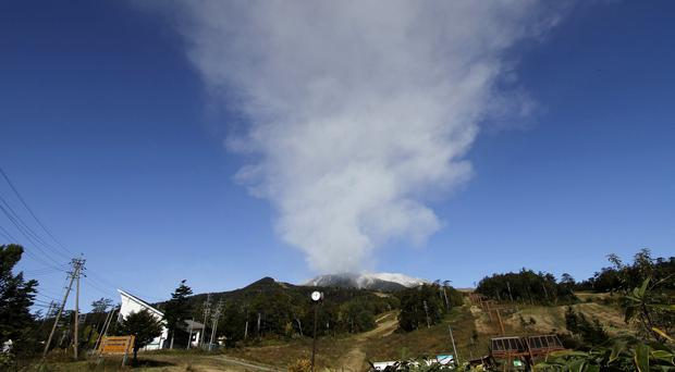 Plumes of smoke and ash billow from Mount Ontake as it continues to erupt for the third day in Otaki village, in Nagano prefecture, Japan (AP)