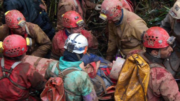 Rescue workers carry injured Spanish speleologist Cecilio Lopez after his rescue from inside the Inti Machay cave in Leimebamba, Peru (AP)