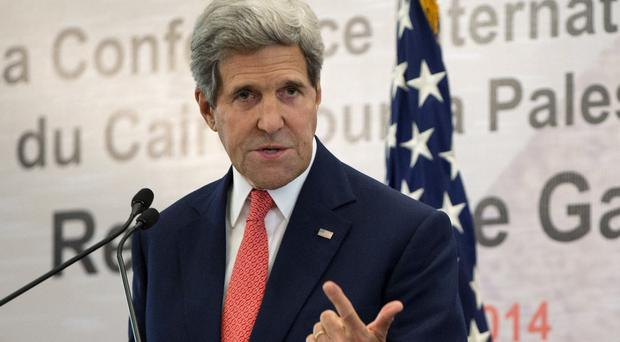 US secretary of state John Kerry makes his point in Cairo, where nations pledged £1.7bn to rebuild Gaza (AP)