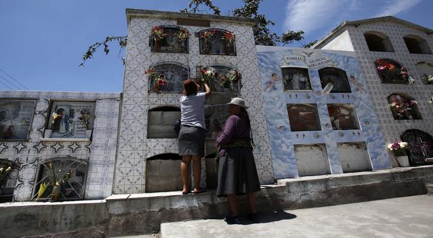 Preparations for the Day of the Dead in Quito, where a court endorsed planned constitutional reforms (AP)