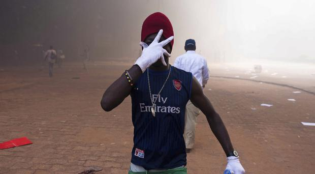 One of the protesters who went on the rampage near the parliament building in Ouagadougou (AP)