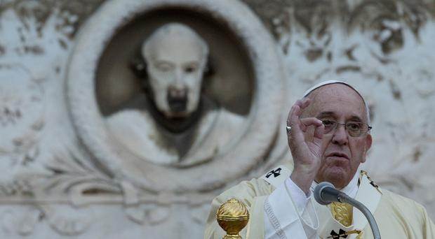 Pope Francis celebrates a mass at Rome's Verano cemetery on the occasion of All Saints Day (AP)