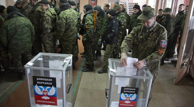 Pro-Russian rebels queue to vote at a polling station during rebel elections in the city of Donetsk, eastern Ukraine (AP)