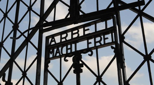 The entrance gate of the former Nazi concentration camp in Dachau near Munich (AP)
