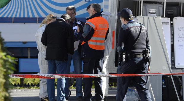 Police and investigators after officers found three bodies in Wilderswil, central Switzerland (AP/Keystone)