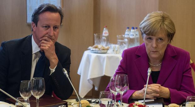 David Cameron and Angela Merkel are in disagreement about the freedom of EU workers to move between countries