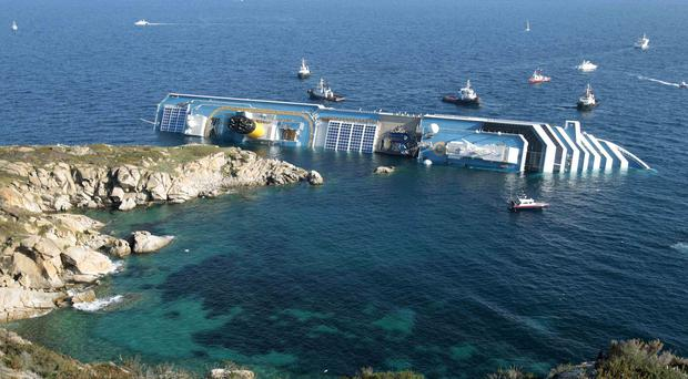 The Costa Concordia capsized after hitting rocks near a Tuscan island in January 2012, killing 32 people (AP)
