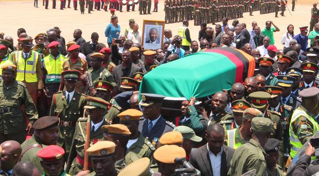 Zambian troops and government officials attend a ceremony to receive the body of president Michael Sata. (AP)