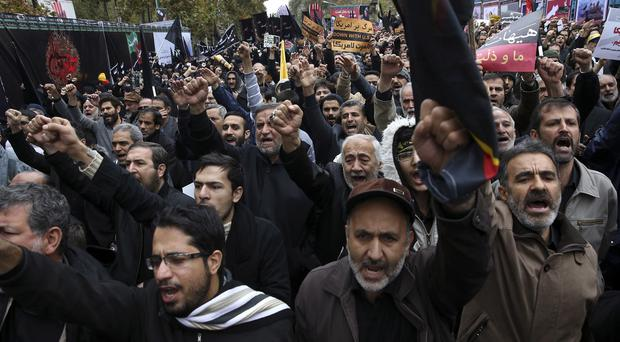 Iranians chant slogans in an anti-US demonstration in Tehran. (AP)