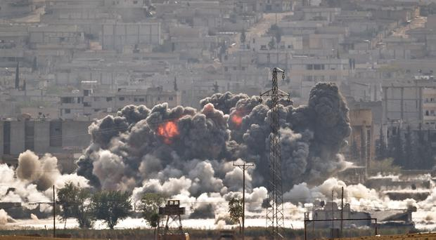 An Islamic State position in Kobani is targeted during air strikes by the US-led coalition. (AP)