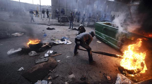 Palestinians burn tyres during clashes with Israeli police in Jerusalem. (AP)