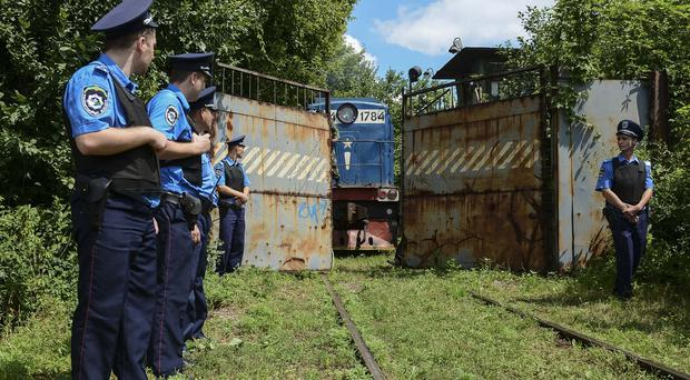 Police secure a refrigerated train loaded with bodies of passengers from Malaysia Airlines flight MH17. (AP)