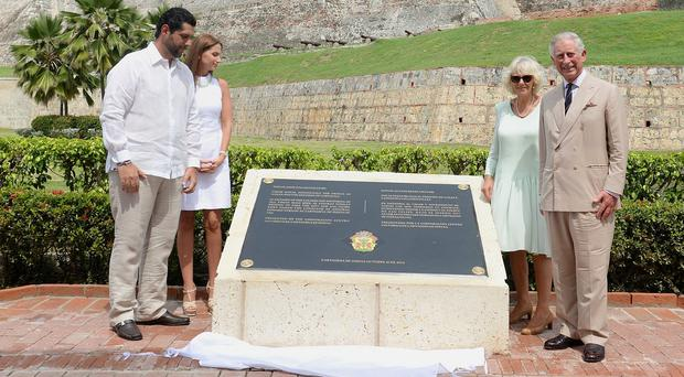 Charles and Camilla unveil the commemorative plaque at the Fort of San Felipe, Cartagena