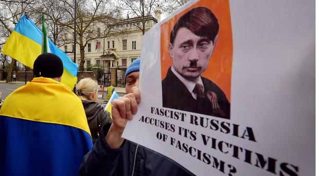British-based Ukrainians gather outside the Russian Embassy in London to protest