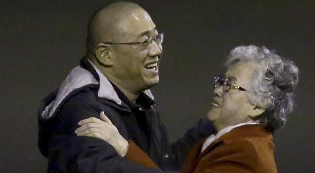 Kenneth Bae greets his mother Myunghee Bae after arriving at Joint Base Lewis-McChord, Washington (AP)