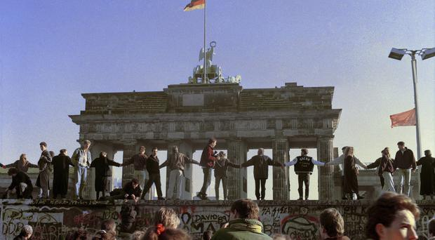 People sang and danced on top of the Berlin Wall when it fell 25 years ago (AP)