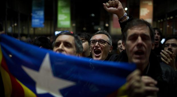 Pro-independence supporters celebrate the results of an informal poll for Catalonian independence (AP)