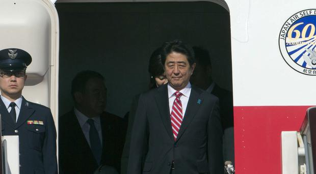 Japanese prime minister Shinzo Abe arrives for the Asia-Pacific Economic Cooperation Economic Leaders' Week at the airport in Beijing (AP)
