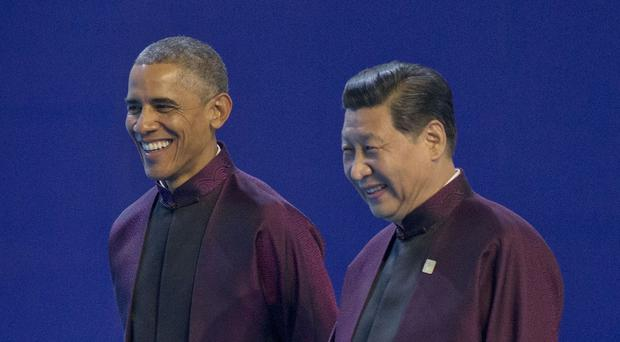 US president Barack Obama, left, and Chinese president Xi Jinping during the Asia-Pacific Economic Cooperation Summit (AP)