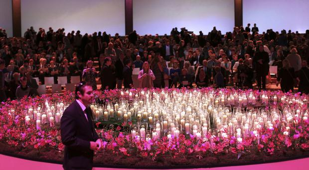 Grieving family members and friends of victims of the Malaysia Airlines Flight 17 disaster gather in Amsterdam (AP)