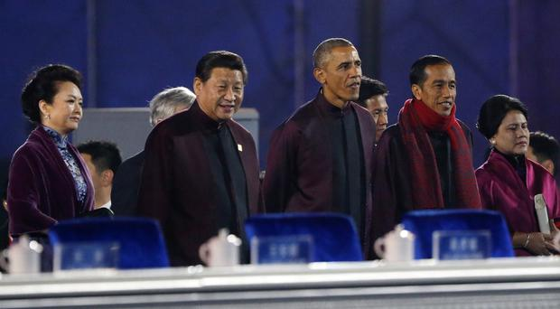 Barack Obama stands with Chinese president Xi Jinping at the APEC summit. (AP)