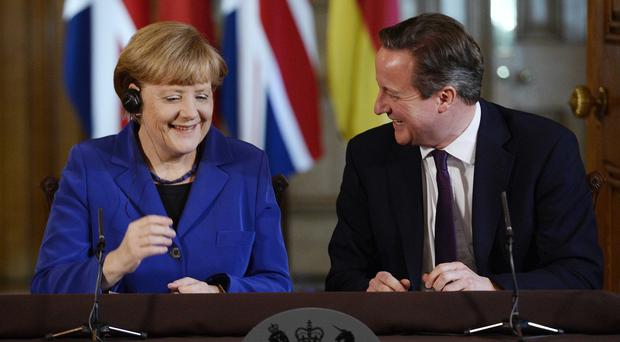 Prime Minister David Cameron and German Chancellor Angela Merkel during a news conference at 10 Downing Street