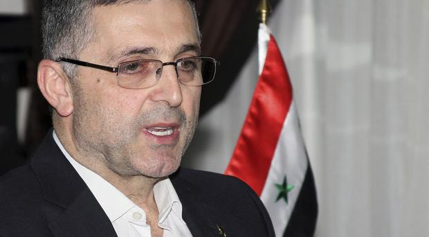 Syrian minister of national reconciliation Ali Haidar speaks in Damascus (AP)