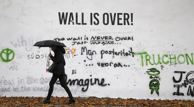 A Prague wall that had been a tribute to John Lennon has been painted white but new messages have started to appear there (AP)