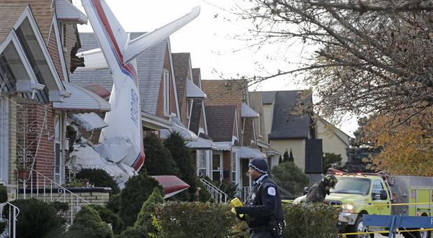 A small twin-engine cargo plane has crashed into a home on Chicago's southwest side (AP)