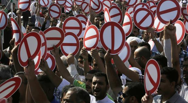 Hundreds of Bahrainis head to the streets for an unauthorised flash march in support of an opposition-called boycott of the elections (AP)