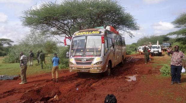 Kenyan security forces gather at the scene of the bus massacre near Mandera (AP)